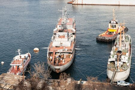 Military support vessel mooring operations with a tug in Yuzhnaya Bay, one of the harbour bays in Sevastopol, Crimea