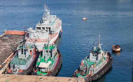 Tugboats and Military ships are in Yuzhnaya Bay, it is one of the harbour bays in Sevastopol, Crimea