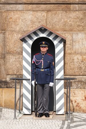 Prague, Czech Republic - May 1, 2017: Guard is at the post at the entrance of the Prague Castle, Matthias Gate Editorial