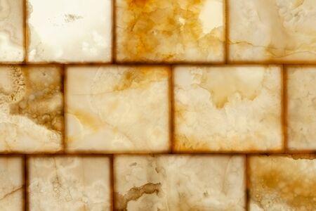Natural honey onyx decorative wall panels with back lit illumination, close-up background photo texture