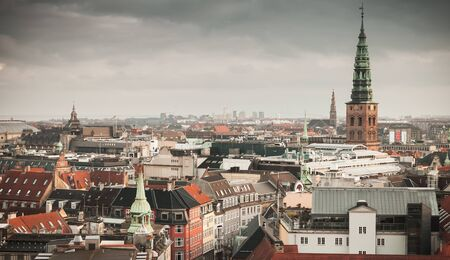 Skyline of Copenhagen, Denmark. Old town with spire of City Hall at winter day. Photo taken from The Round Tower, popular old city landmark and viewpoint Stock fotó