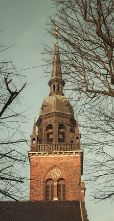 Bell Tower on Church of the Holy Ghost in Copenhagen, Denmark. Vintage toned photo with retro tonal correction filter effect