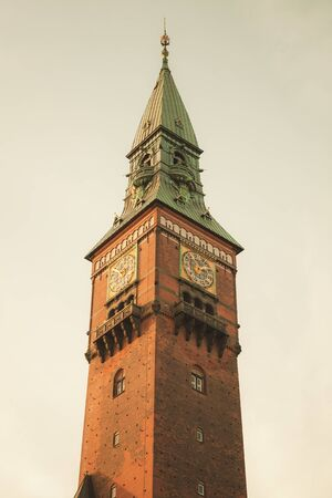 Clock tower of Copenhagen city hall, Denmark. Vintage toned photo with retro tonal correction filter effect Stock fotó