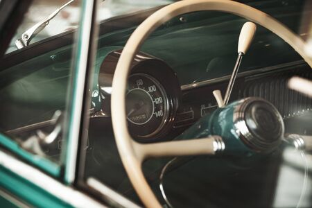 White steering wheel and dashboard of an old timer car. Close up photo with soft selective focus Stock fotó