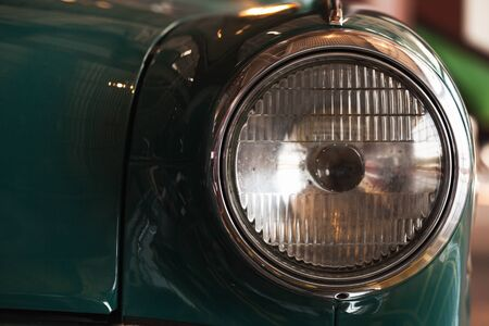 Classic round headlight. Old timer car details. Close up photo with soft selective focus