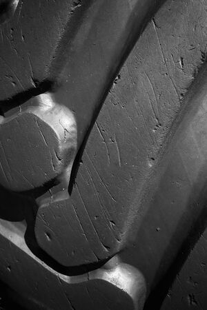 Old used tractor wheel, tread pattern. Close up vertical photo Stock fotó