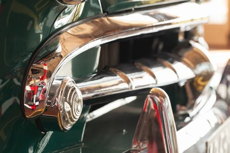 Front bumper with running lights. Old timer chrome car details. Close up photo with soft selective focus