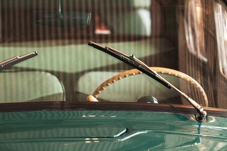 Windshield wiper and steering wheel. Old timer car details. Close up photo with soft selective focus