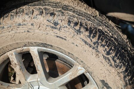 Dirty 4x4 SUV car wheel with light alloy disc, closeup photo, off-road racing theme Stock fotó