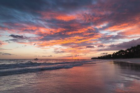 Colorful clouds at sunrise over Atlantic Ocean coast, Bavaro beach, Dominican Republic, natural coastal landscape