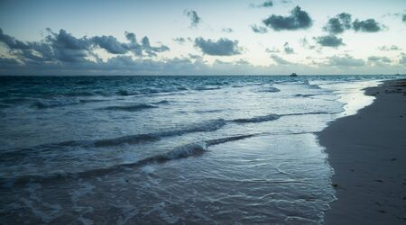 Morning landscape at Atlantic ocean coast. Dominican republic. Bavaro beach. Blue toned photo