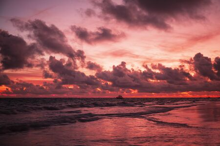 Red tropical sunrise over Atlantic Ocean, Bavaro beach coastal landscape, Dominican Republic Stock fotó