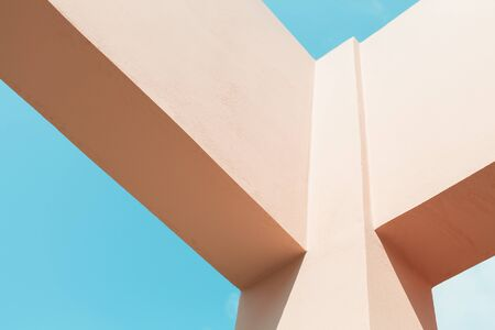 Abstract contemporary architecture fragment, pink painted concrete beams corner under blue sky Stock fotó
