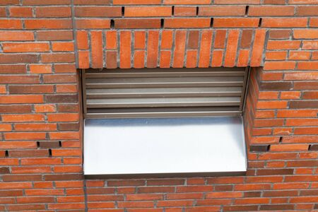 Ventilation window with metal grille in old brick wall Stock fotó