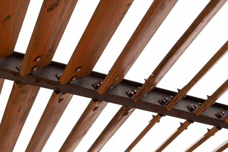 Sunshade structure isolated on white. Wooden inclined wooden planks mounted on steel beams