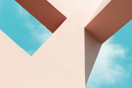 Abstract contemporary architecture, pink painted concrete structure under blue sky