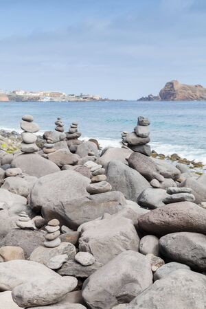 Cairns on the beach of Ribeira da Janela, Madeira island, Portugal