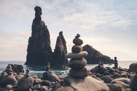 Cairns and dark rocky Islets of the Ribeira da Janela, Madeira island, Portugal