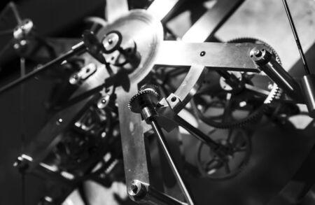Vintage world clock mechanism, fragment with shiny cog wheels. Zdjęcie Seryjne