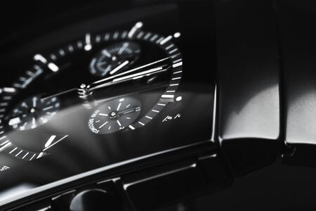 Luxury wrist watch made of black high-tech ceramics. Close-up studio photo with selective focus