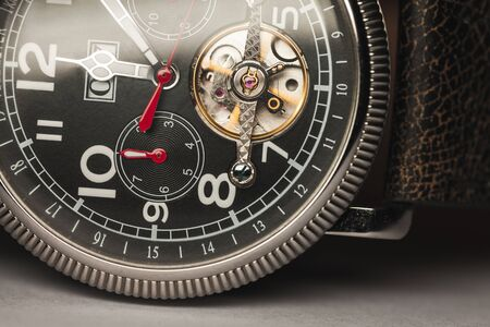 Mechanic luxury wrist watch with automatic winding lay on a table, closeup fragment Reklamní fotografie