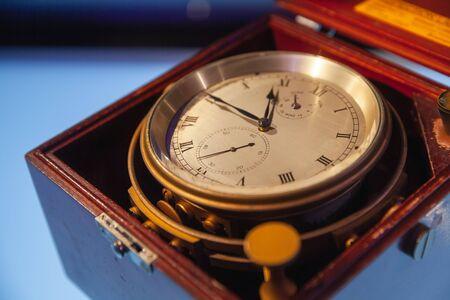 Vintage naval clock in wooden box, close up photo 版權商用圖片