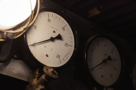 Vintage industrial manometers show zero pressure, close-up photo with soft selective focus