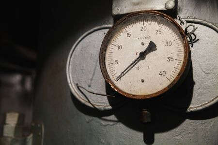 Vintage industrial manometer shows zero pressure, close up photo with soft selective focus