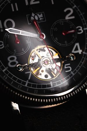 Mechanic luxury wrist watch with automatic winding, close-up vertical photo Reklamní fotografie