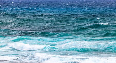 Blue stormy shore water of Mediterranean Sea with waves, panoramic background photo taken from coast of Cyprus island Stock Photo