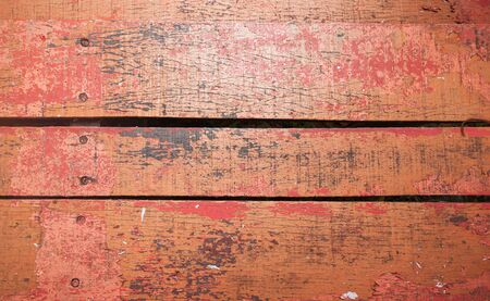 Grungy red wooden desk, top view, background photo texture