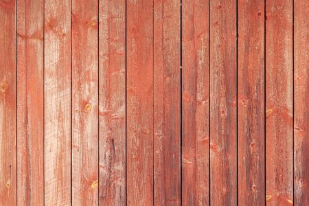 Grungy red wooden wall made of painted pine tree planks, background photo texture Archivio Fotografico - 130137065