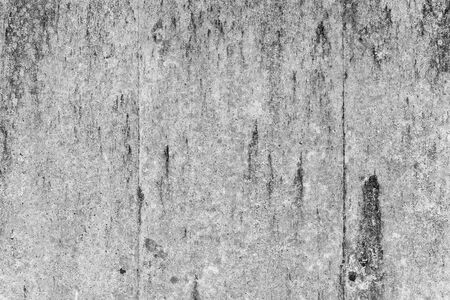 Old weathered grungy concrete wall with black smudges. Abstract background photo texture 版權商用圖片