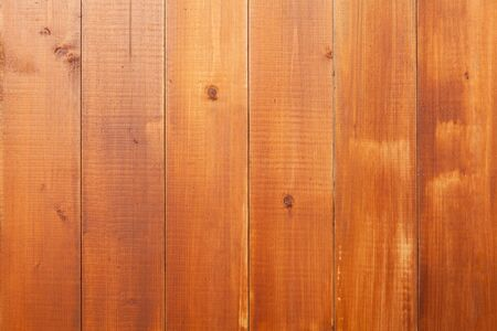 Natural wooden wall made of toned pine tree planks. Background photo texture