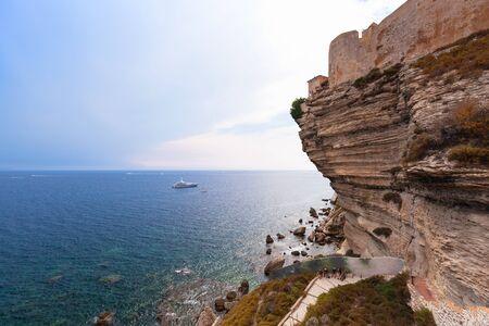 Cliffs with old stone houses. Coastal landscape of Bonifacio town. Corsica island, France