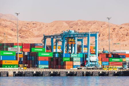 Aqaba, Jordan - May 17, 2018: Rubber tyred gantry cranes work in Aqaba container terminal at sunny day Redactioneel