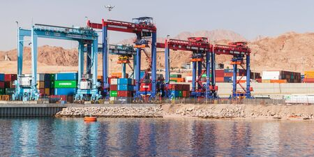 Aqaba, Jordan - May 17, 2018: Rubber tyred gantry cranes work in Aqaba container terminal, Jordan Redactioneel