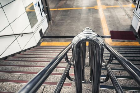 Abstract urban transportation  with shiny steel railings in underground crossing