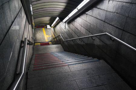 Empty dark underground crossing perspective.