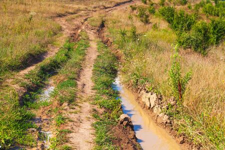 Wet empty dirty rural road perspective, background photo Banque d'images