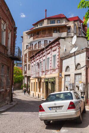 Tbilisi, Georgia - April 29, 2019:  Old Tbilisi vertical street view, people walk the street