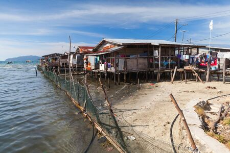Wooden houses and footbridges on stilts. Poor coastal district of Kota Kinabalu, Malaysia
