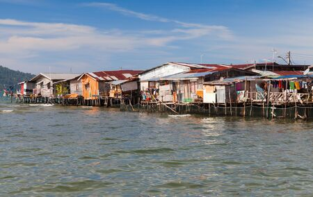 Colorful wooden houses and on stilts in poor district of Sabah, Kota Kinabalu, Malaysia