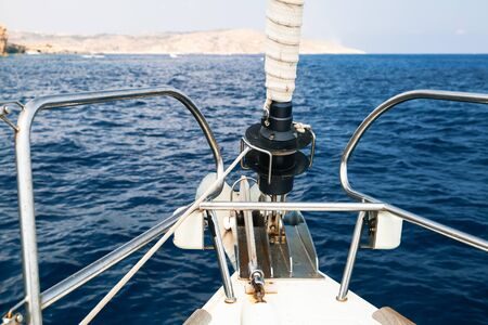 Sailing yacht bow with jib furler and anchor