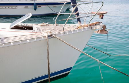 White yacht bow with mooring ropes and anchor Banco de Imagens