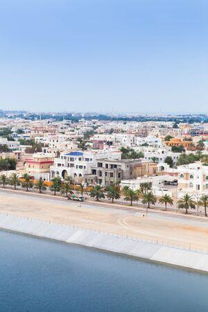 Abu Dhabi, bird eye view, vertical photo. Coastal cityscape with living houses