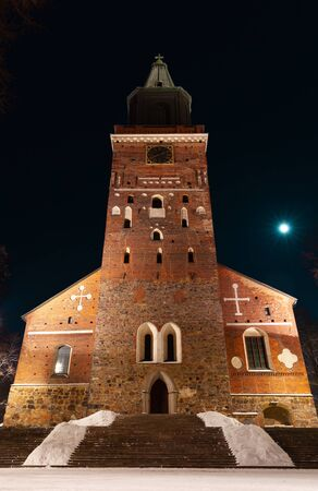 Turku Cathedral exterior at winter night, Finland. Vertical photo