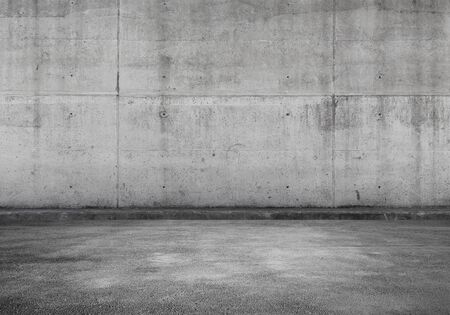 Empty parking lot, interior background with gray concrete wall and asphalt flooring, abstract photo texture Stockfoto