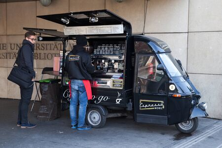 Vienna, Austria - November 4, 2015: Customer and barista of Espresso Mobil coffee to go are on the street of Vienna