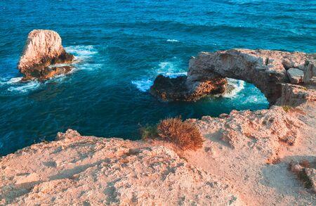 Landscape with natural stone arch known as the Love bridge. Ayia Napa, Cyprus island.  Mediterranean Sea coast